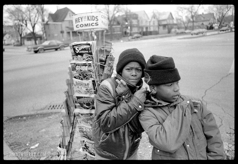 Kids at newsstand at Halsted and 87th in Chicago. Shot in 1991 by Jim Newberry.