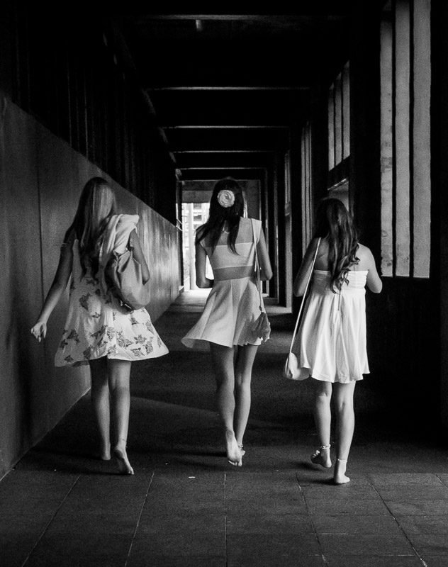 Barefoot, dressed up teenage girls in Wellington, New Zealand. Photo by Jim Newberry.