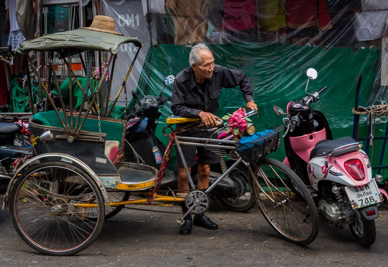 Cycle rickshaw and driver in Chiang Mai, Thailand. Photo by Jim Newberry.