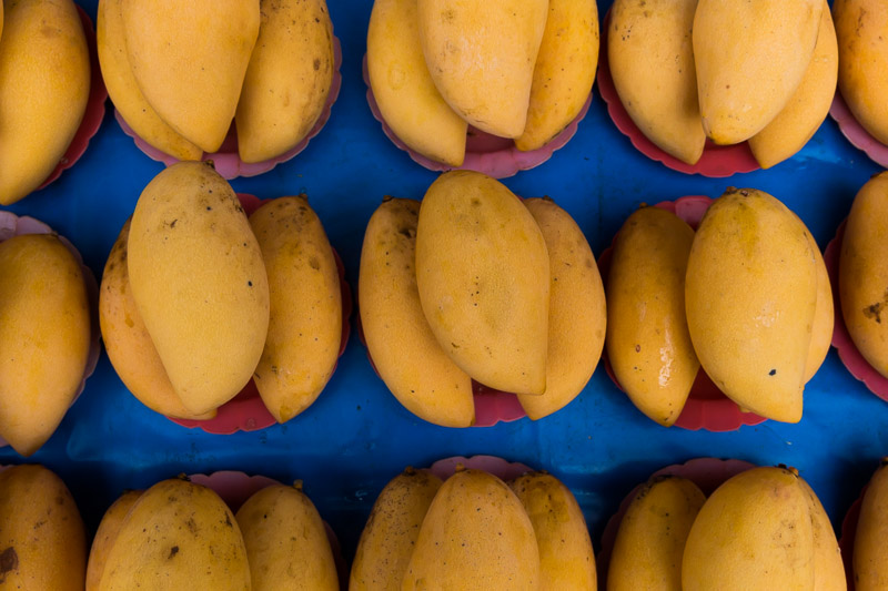 Mangoes photographed in a street market in Chiang Mai, Thailand, by Jim Newberry.