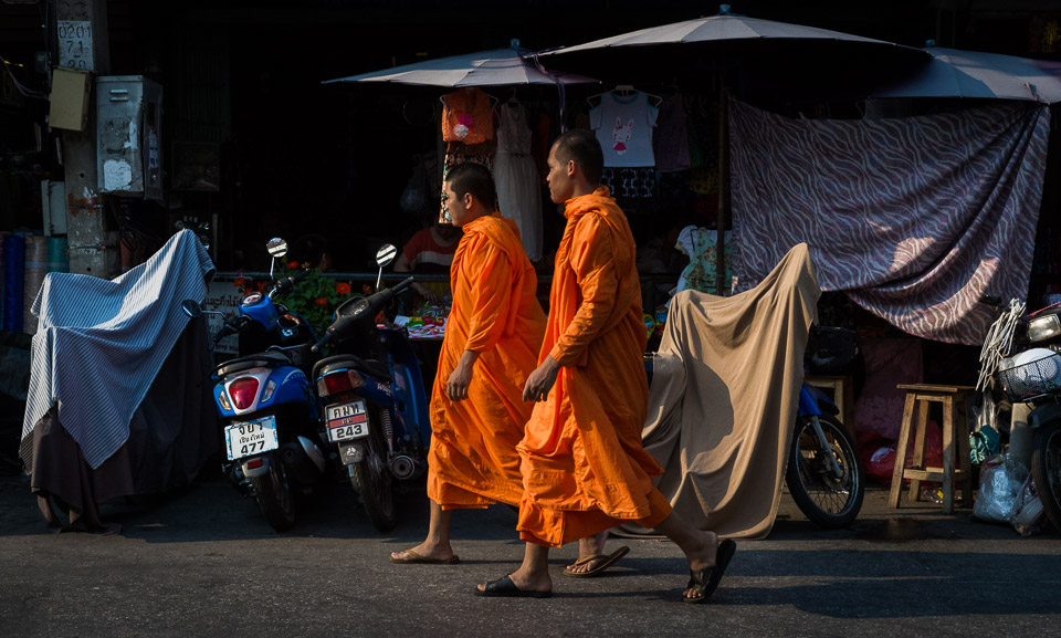 Orange-robed monks in Chiang Mai, Thailand. Photo by Jim Newberry.