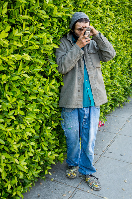 A man named Will taking a photo on Figueroa in Los Angeles.