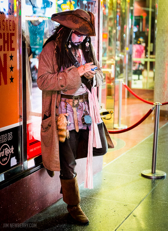 Texting pirate on Hollywood Boulevard. Photo by Jim Newberry.