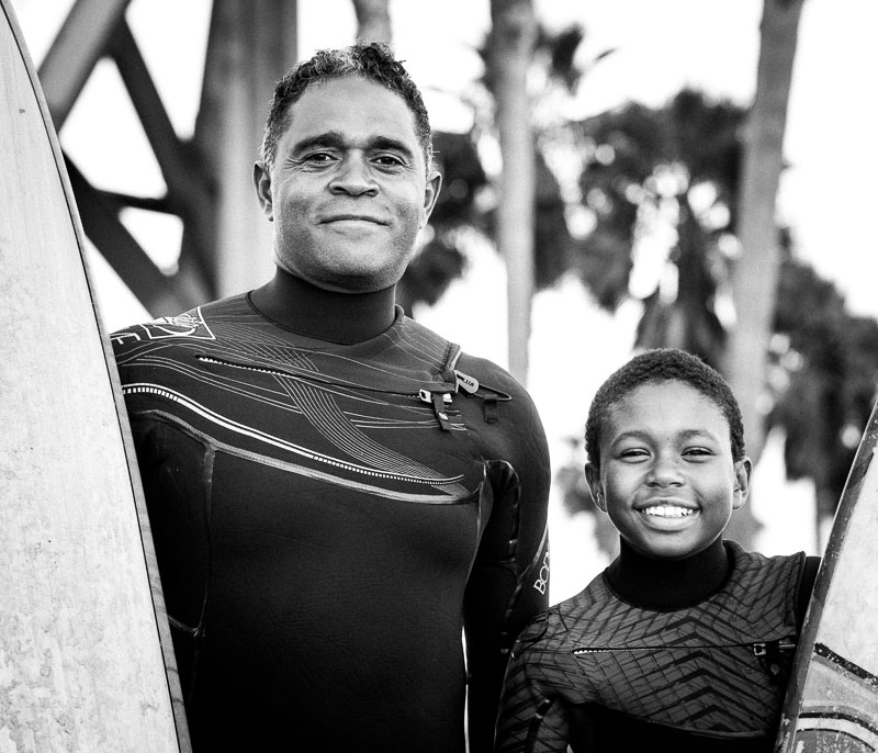 Father and son surfers Greg Sr. and Greg Jr. at  Venice Beach in Los Angeles. Photo by Jim Newberry.