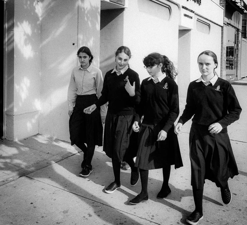Girls in school uniforms walking on Beverly Boulevard in Los Angeles, California. Photo by Jim Newberry.