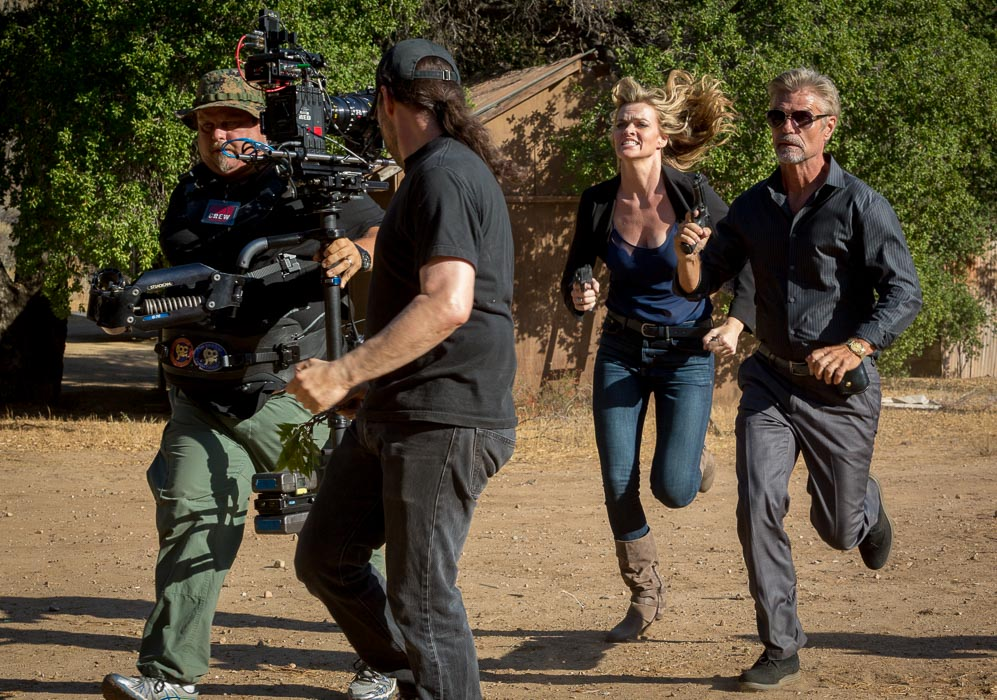 Adam Rifkin directs a scene with Missi Pyle and Harry Hamlin